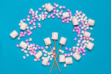 Marshmallows on color background