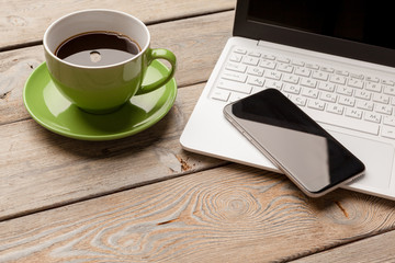 Laptop Coffee Cup Office Concept close up