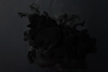 Wall Mural - black paint splash on dark background