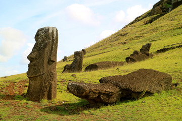 Uncountable giant Moai statues scattered on the slope of Rano Raraku volcano, Easter Island, Chile, South America