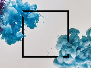 blue splashes of paint with square frame on white background