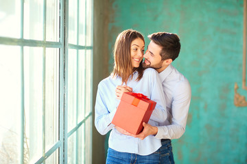 Loving couple with red gift box
