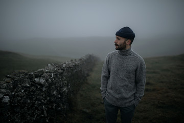 Man on a foggy field