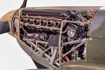 A close up detailed photograph of the Merlin fitted in a supermarine spitfire. A British liquid-cooled V-12 piston aero engine of 27-litres capacity.