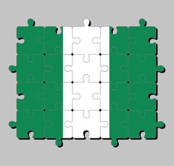Jigsaw puzzle of Nigeria flag in a vertical bicolor triband of green, white and green. Concept of Fulfillment or perfection.