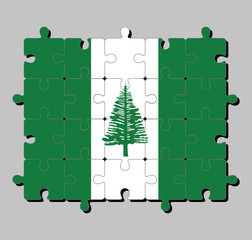 Jigsaw puzzle of Norfolk Island flag in Norfolk Island Pine in a central white stripe between two green stripes. Concept of Fulfillment or perfection.