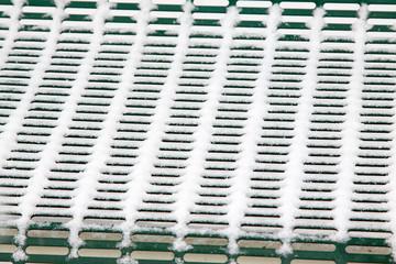 Metal net cover in snow