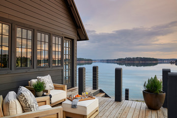 Wooden house with terrace over lake