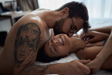 Tenderness in every touch. couple in bedroom..