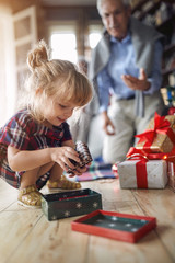 little girl holding a Christmas present.