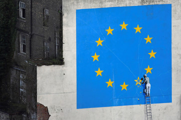 A large mural depicting the EU flag being chipped away and attributed to the British artist Banksy is seen at the Port of Dover in south east Britain