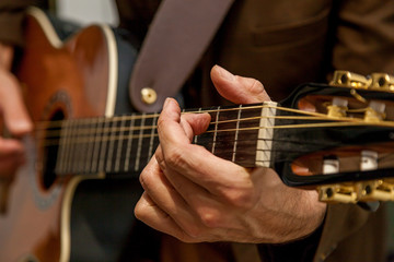 musician plays guitar close up