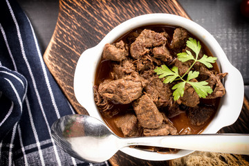 Beef meat stew in ceramic pot.