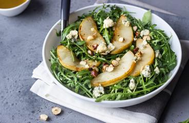 Arugula, gorgonzola cheese, caramelized pear and nut salad. Healthy food. Light breakfast, lunch or...