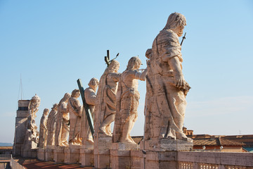 Sculptures on the roof of the Cathedral of St. Peter on a sunny day