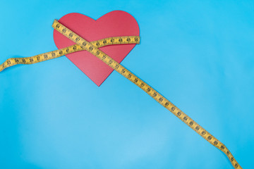 Tape measure and red heart