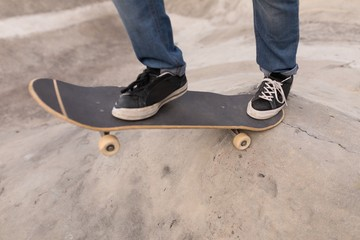 Man skateboarding at skateboard park