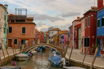 Burano Island - part of Venice, colored houses on the background of the channel.
