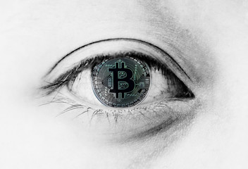Close up at bitcoin In the eye It represents ever-changing digital currency investment. Data must be best understood because of the risk of loss. Or to be successful. And the income is millionaire.