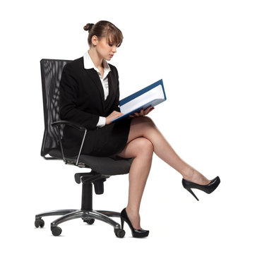 business woman sitting reading documents, isolated on white background