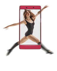 Portrait of beautiful young professional dancer on white background. conceptual image with a smartphone, demonstration of device capabilities