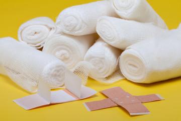 Plaster bandage roll and scissors