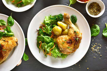 Baked chicken leg with potato and green salad