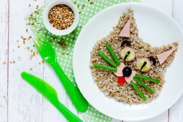 Healthy breakfast for kids - buckwheat porridge shaped cute cat, animal face food idea