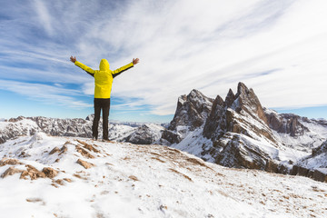 Successful man on top of snowy mountain