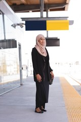 Woman standing on platform at railway station