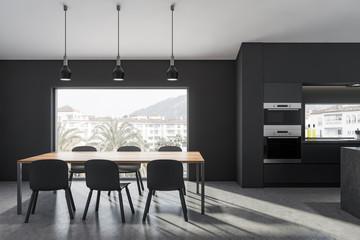 Dark gray dining room with window
