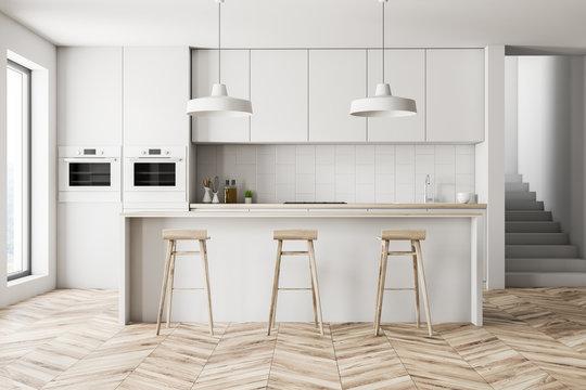 White kitchen interior with bar