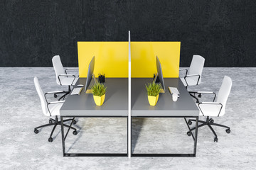 Gray office tables in black room