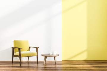 Armchair and table in white and yellow room