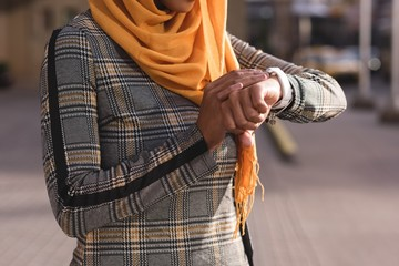 Woman using smart watch in city