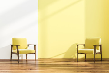 Two armchairs in white and yellow room