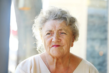 Elderly woman tired and sad looking face