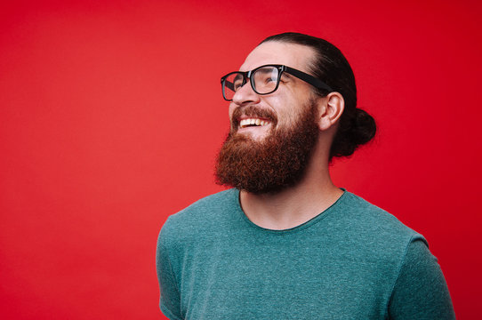Portrait of cheerful bearded man and lokking away