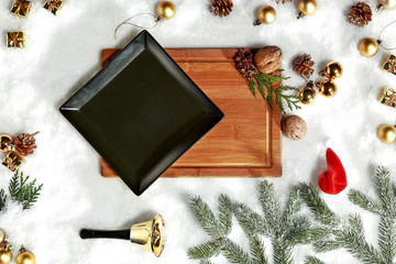 A winter composition on a wooden table in the glow of a fireplace and a Christmas tree decoration on a magical evening