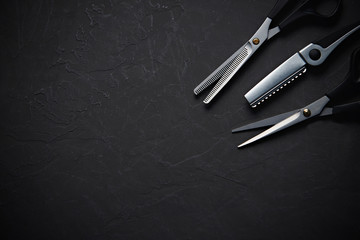 Hairdressing tools on black background with copy space at top