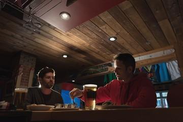Friends enjoying their drinks in pub