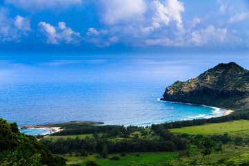 Aerial view overlooking the tropical island of Kauai and the Pacific Ocean, Hawaii.