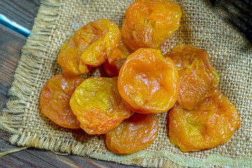 dried apricots on the background of a wooden table