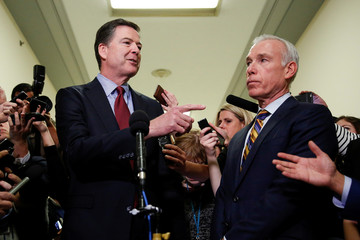 Former FBI Director James Comey speaks to the media as his attorney David Kelley watches after giving a private deposition to the House Judiciary and House Government and Oversight committees on Capitol Hill in Washington