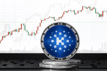 Kin (KIN) cryptocurrency; kin coin on the background of the chart