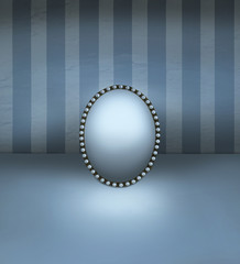 Spoed Fotobehang Surrealisme Small mirror with vintage frame decorated in pearls resting on a floor and with striped wall background