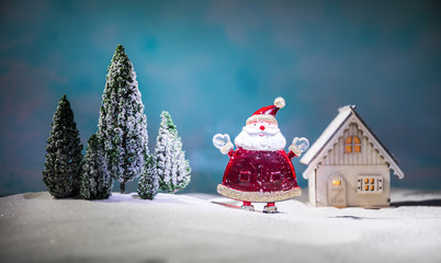 festive background. snowman dressed as Santa Claus with Christmas balls on light background photo has an empty space for your text