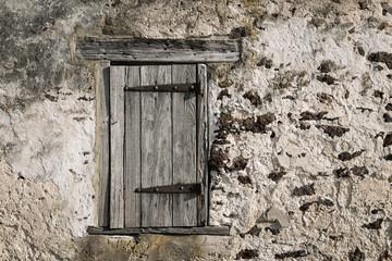 Old stone barn facade.