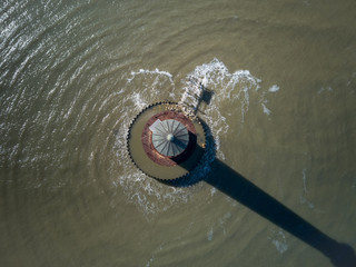 Aerial drone image of the historic Morris Island Lighthouse now inactive but destroyed during the Civil War and eroded by storms and global warming