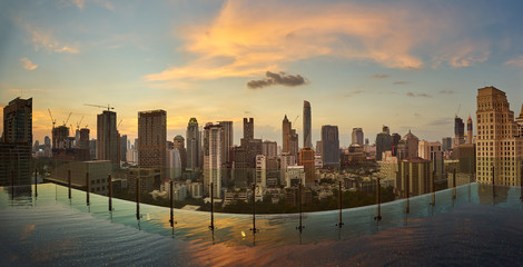 Bangkok beautiful twilight sunset view with skyscraper in business district in Bangkok Thailand. Panorama wide angle view .